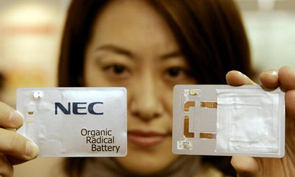 An employee of NEC shows off a card-size